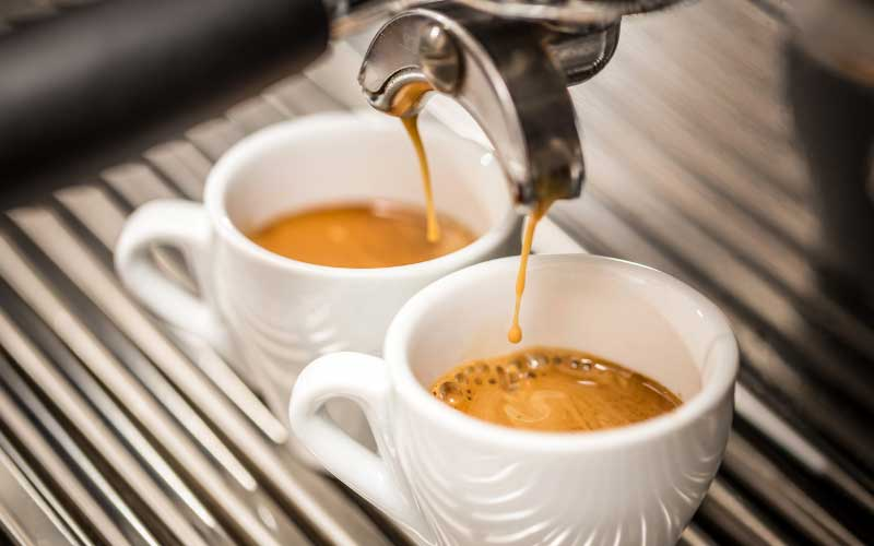 Image of two espressos. This image is the featured image on a buying guide to small espresso machines