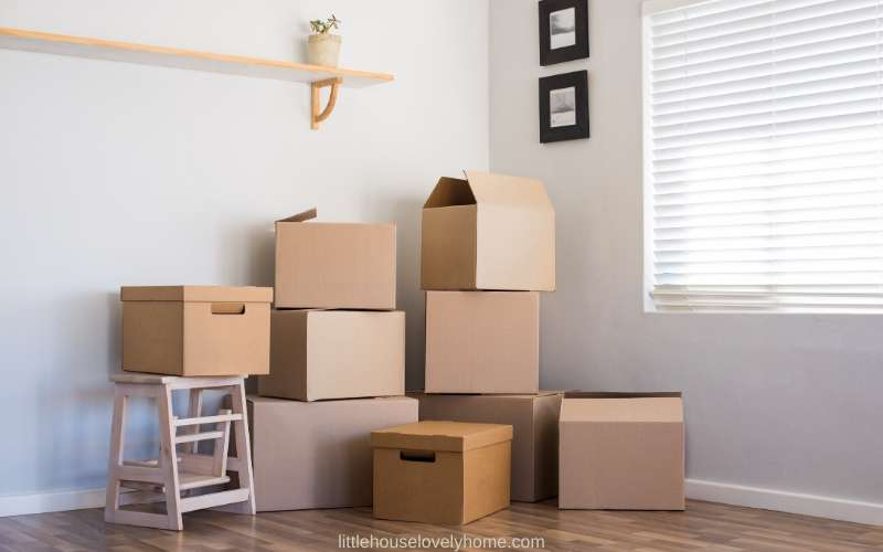 Picture of moving boxes in the corner of a white room
