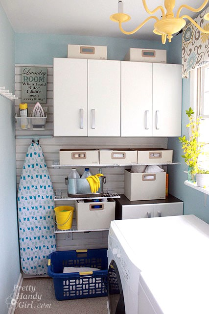 A small laundry room with a slat wall