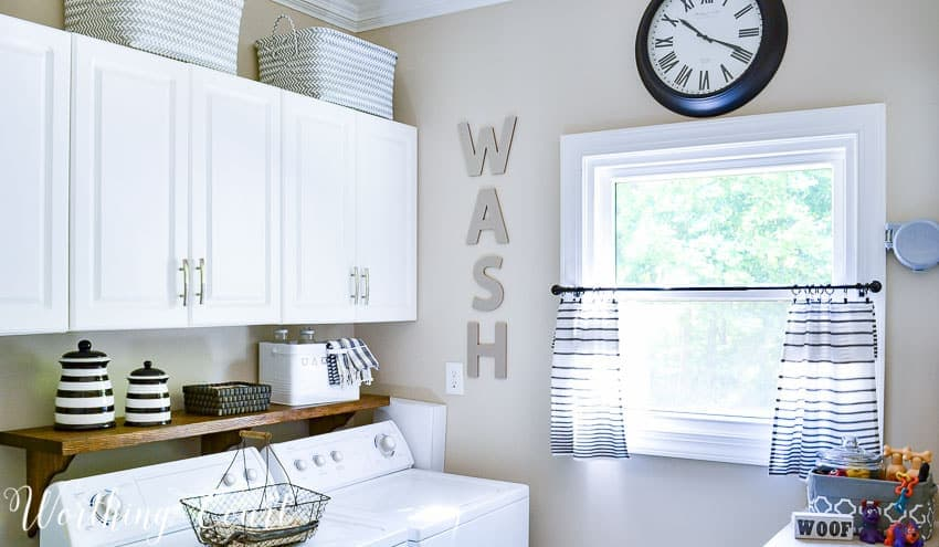 A laundry room with the word WASH on the wall