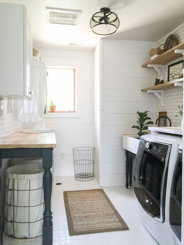 Farmhouse Laundry Room With Butcher Block Countertops and Shiplap