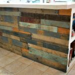 A kitchen island made out of wood pallets