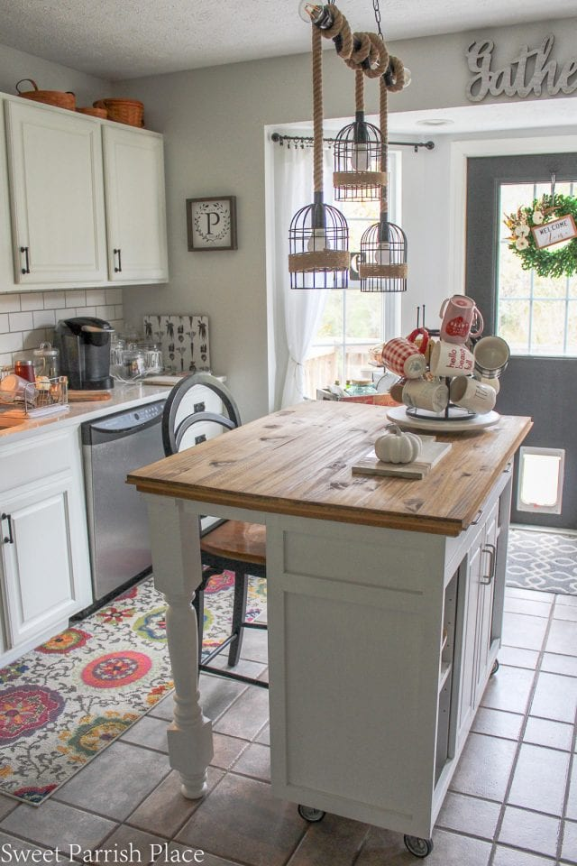A kitchen island with a wood countertop