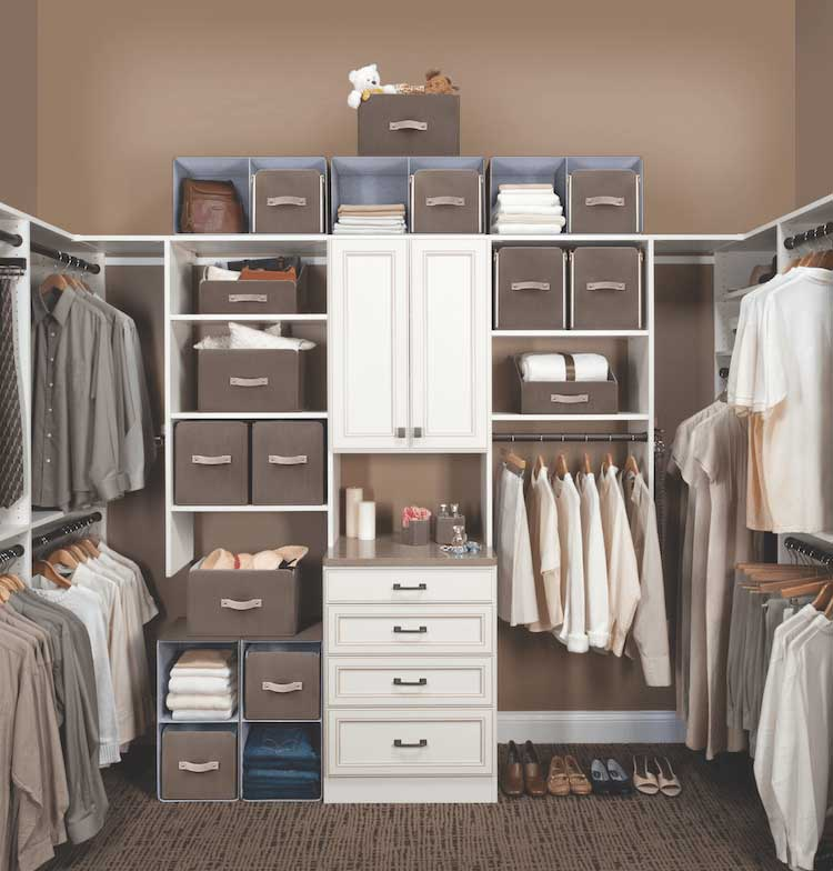A white and cream and brown-colored walk-in closet