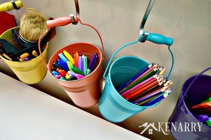 Art supplies hanging in buckets