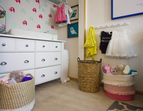 A small nursery with a changing table in a closet