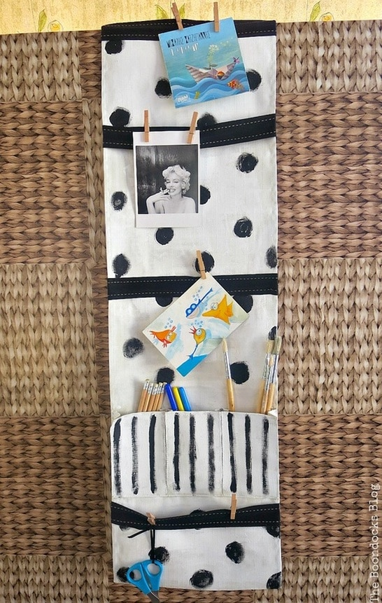 a white hanging organizer with black polka dots