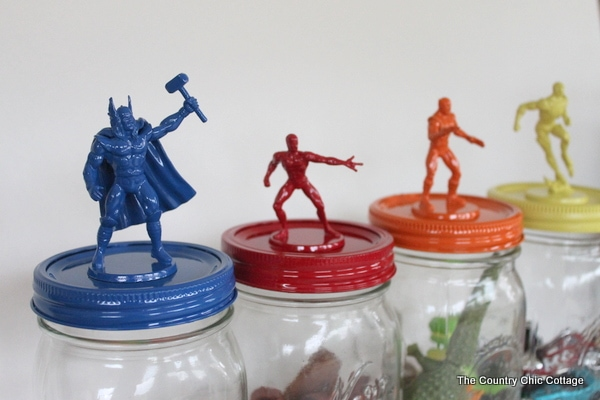 Mason jars with super heroes on the lids