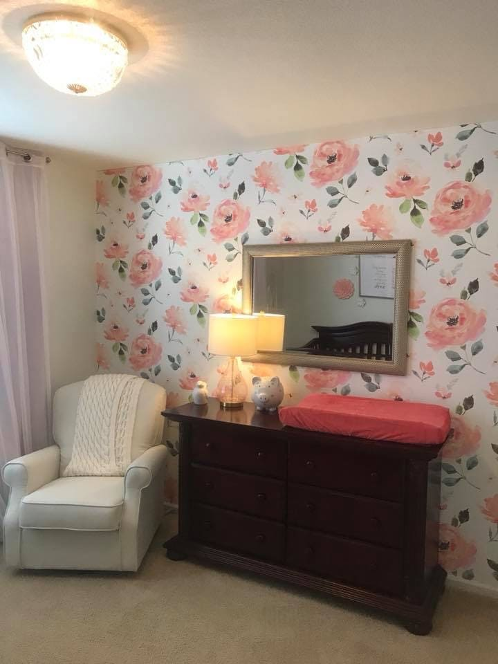 A dresser in a nursery doubles as a changing table