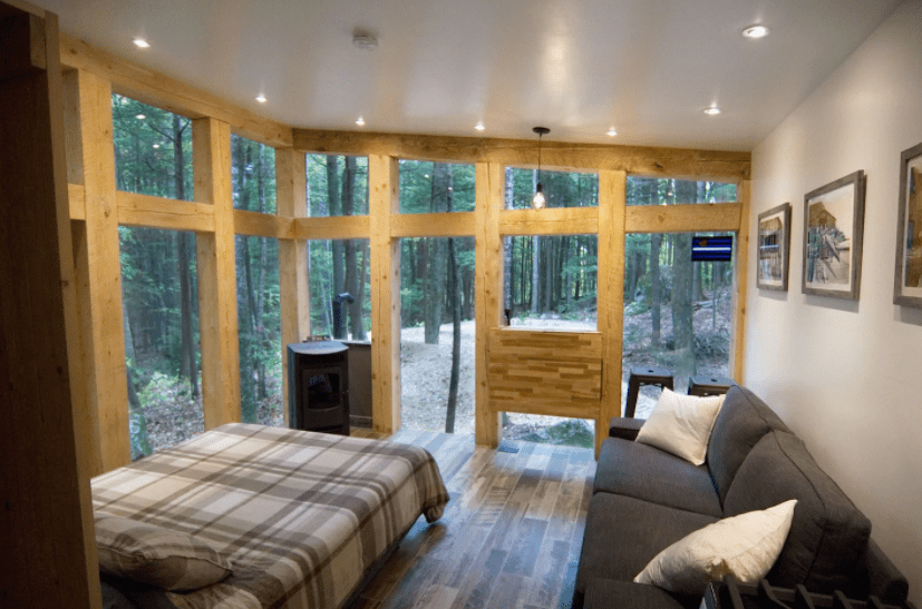 The bedroom of a tiny house in Maine