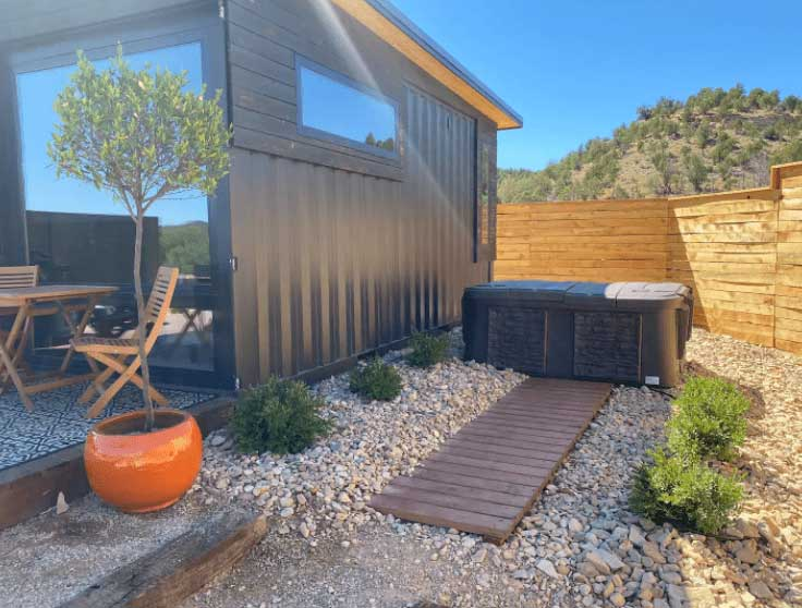 A tiny house in Utah with a hot tub