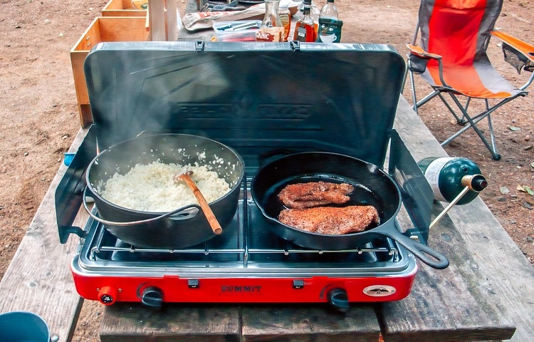 making lunch on camping propane stove
